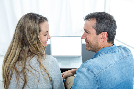 each other: Couple looking at each other and smiling Stock Photo