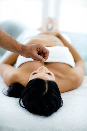 Pregnant woman receiving a spa treatment from masseur at home Stock Photo