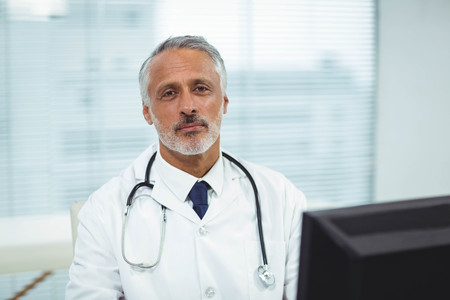 obstetrician: Portrait of doctor working on his computer in cabin Stock Photo