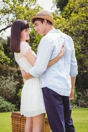 each: Young couple embracing each other in garden Stock Photo