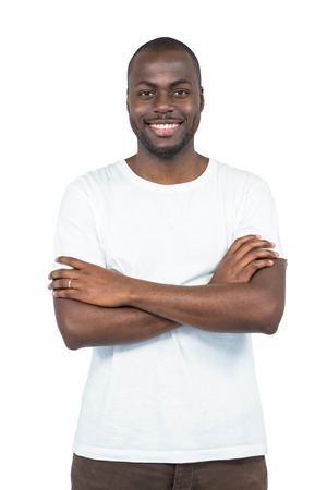 handsom: Portrait of man smiling and standing with arms crossed on white background Stock Photo