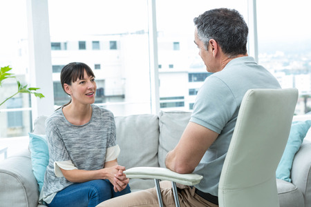 Woman consulting a therapist in clinic