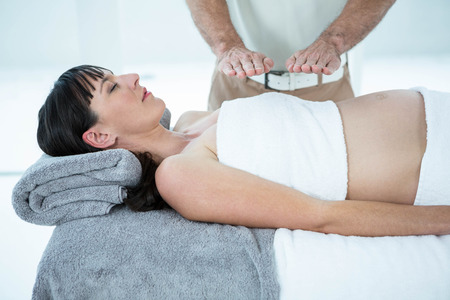 Pregnant woman receiving a massage from masseur at the health spa Stock Photo