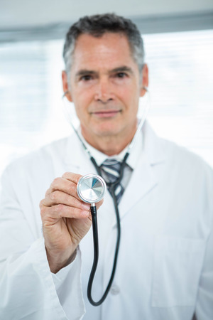 obstetrician: Portrait of confident doctor with stethoscope in clinic