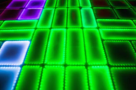 illuminated: Green illuminated disco dance floor in bar Stock Photo