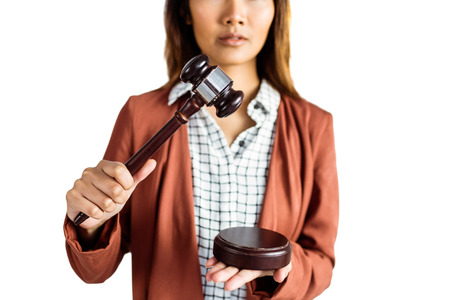 banging: Businesswoman banging a law hammer on the gavel on white background Stock Photo