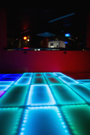 dance floor: Blue and green illuminated disco dance floor in bar Stock Photo
