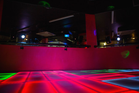 Red illuminated disco dance floor in bar Stock Photo