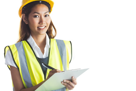 yellow helmet: Architect woman with yellow helmet and plans on white background