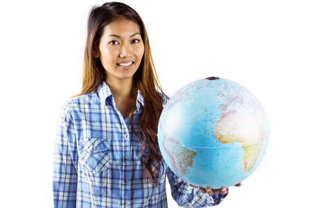 world thinking: Smiling asian woman holding a globe on a white background
