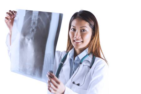 mri scan: Asian doctor checking MRI scan on white background