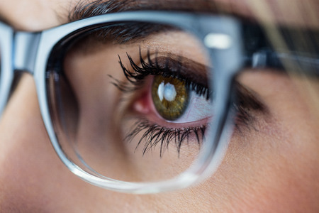 green eyes: Close-up of a woman with green eyes wearing glasses