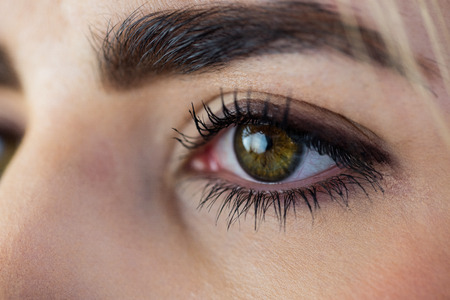 green eye: Close-up of a womans green eye Stock Photo