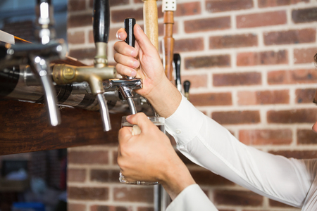 masculine: Masculine hands pouring beer in a bar