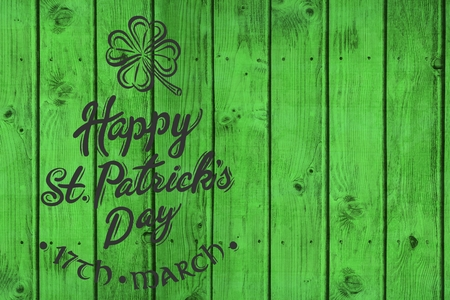 17th of march: St patricks day greeting on wooden background