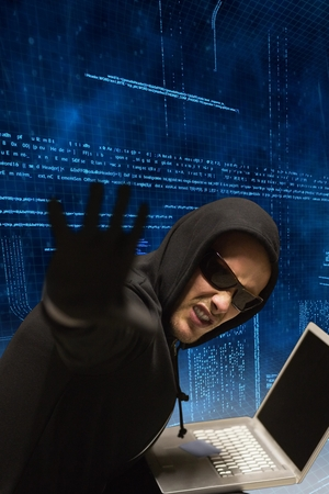 to steal: Hacker using laptop to steal data Stock Photo