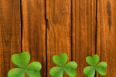 saint patty: Picture of shamrock for st patricks day on wooden background Stock Photo