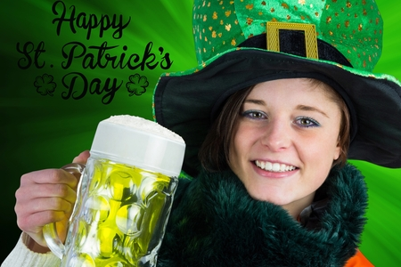 st patty day: Irish girl holding beer on green background