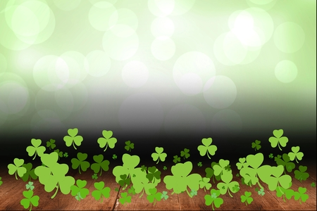 clovers: Three leaf clovers on green background Stock Photo