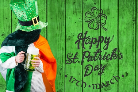 st patty day: Person celebrating st patricks day in front of green wood Stock Photo
