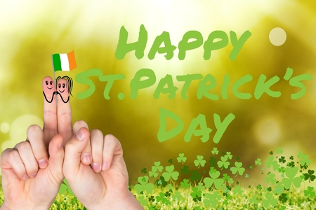 saint patty: Patricks day fingers with irish flag on bright background Stock Photo