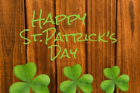 cloverleaves: Happy st patricks day on wooden background Stock Photo