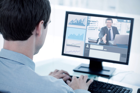 businessman working at his computer: Happy businessman offering his hand  against back view of a businessman working with a computer Stock Photo