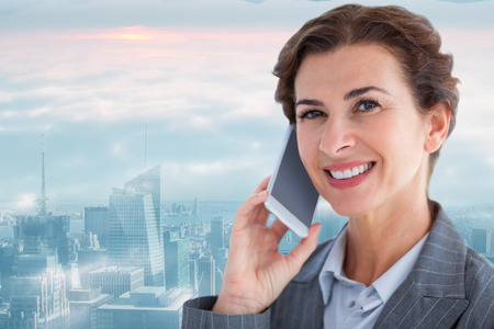 phone professional: Portrait of beautiful businesswoman talking on mobile phone against new york skyline
