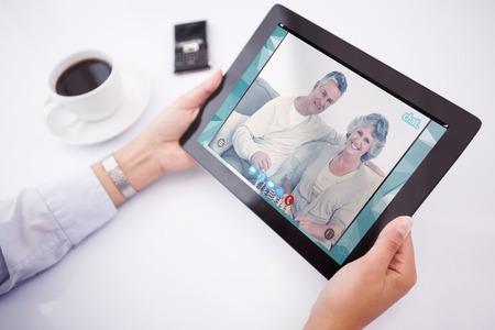 using tablet: Man using tablet pc against music app