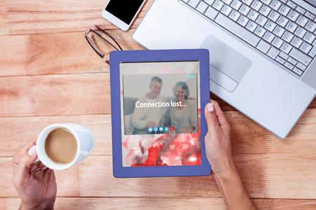 remix: Music app against overhead of feminine hand using tablet