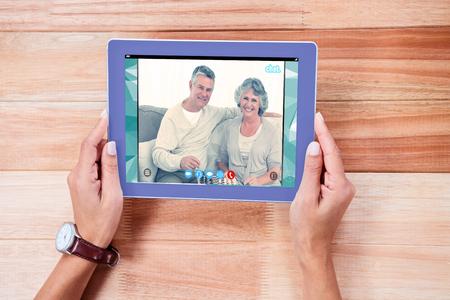 remix: Music app against overhead of feminine hands using tablet