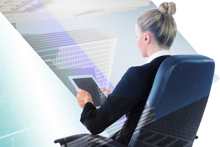 swivel chair: Businesswoman sitting on swivel chair with tablet against new york