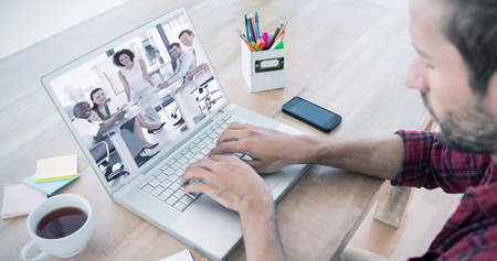 Creative businessman typing on laptop against female business woman giving a presentation photo