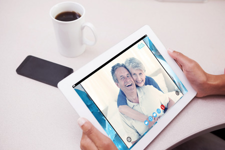 remix: Woman using tablet pc  against music app Stock Photo