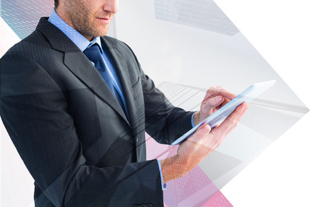 mid section: Mid section of a businessman using digital tablet against skyscraper Stock Photo