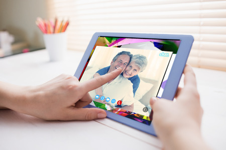 remix: Music app against cropped image of person using on digital tablet Stock Photo