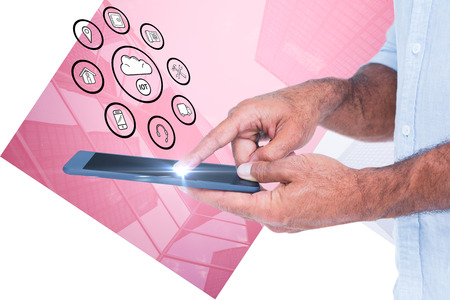 using tablet: A man using tablet computer  against skyscraper Stock Photo