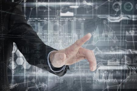 mid adult men: Businessman hand pointing something  against hologram background Stock Photo