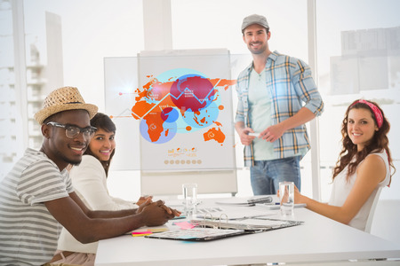 taking notes: Futuristic interface with the world map  against businessman presenting and smiling colleagues listening
