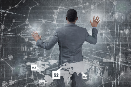 hologram: Businessman standing with hands up against hologram background Stock Photo