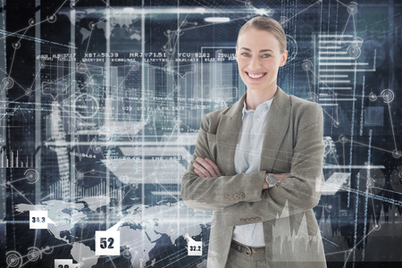 hologram: Portrait of smiling businesswoman standing arms crossed against hologram background Stock Photo