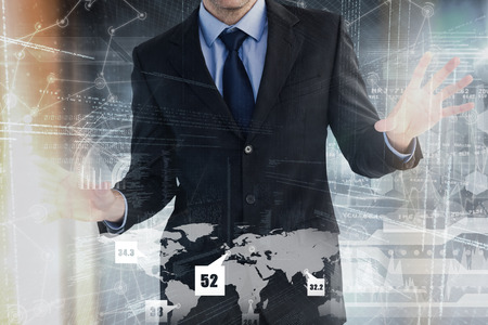 well dressed: Businessman standing with fingers spread out against hologram background Stock Photo