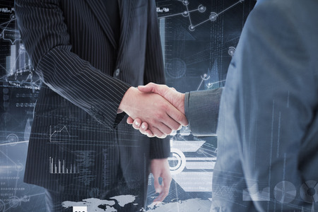 businessteam: Business people shaking hands against hologram background Stock Photo