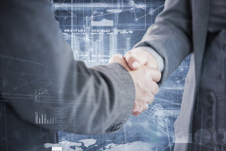 agreement shaking hands: Business people shaking hands close up against hologram background Stock Photo
