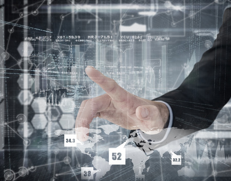 hand pointing: Businessman hand pointing something  against hologram background Stock Photo
