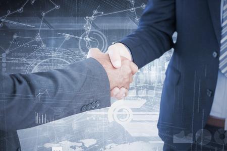 introducing: Businessmen shaking hands against hologram background