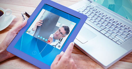 video chat: View of video chat app against woman using her tablet and her laptop