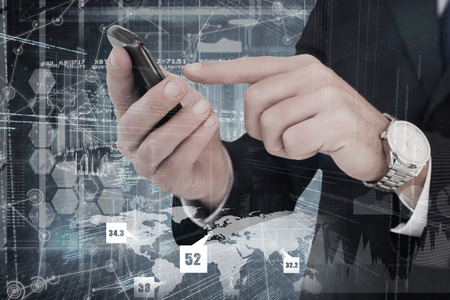 using tablet: Businessman in glasses using his tablet pc against hologram background