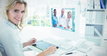 video chat: View of video chat app against portrait of a smiling young woman using computer