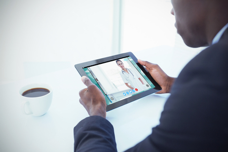video chat: View of video chat app against businessman using digital tablet